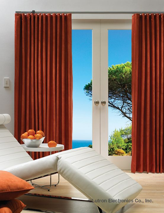 Enjoy summer year round with the cheeriness of orange with these automated curtains. Contact Seven Integration for more information #smarthome #homeautomation
