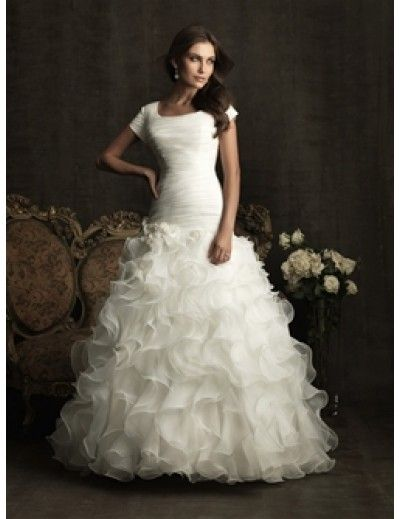 Love this wedding dress! This website has really cute and modest wedding dresses for really cheap prices.