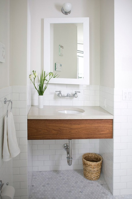 round sink and wood apron. Marble octagon tiles on floor and classic white subway tiles