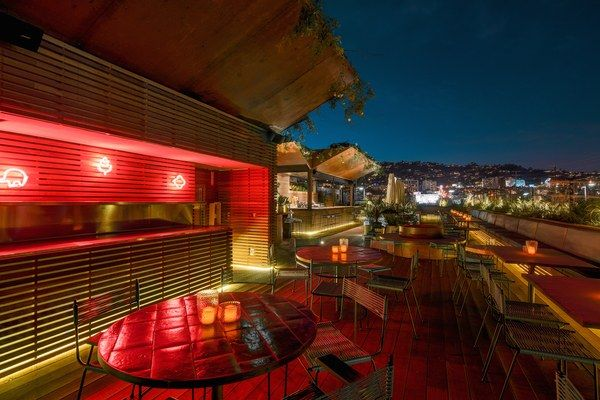At acclaimed Austro-Fijian chef Louis Tikaram's multistory E.P. Asian Eating House in West Hollywood, guests can mingle at the copper-clad bar and green onyx dining counter—designed by Aussie firm Projects of Imagination—or go upstairs to L.P. Rooftop, the topiary-filled and fire-pit-equipped bar overlooking the Hollywood Hills. With a mix of wok stir fry and boba cocktail creations, the place offers the best of Southeast Asia and Southern California under (and atop) one roof. 603 North La…