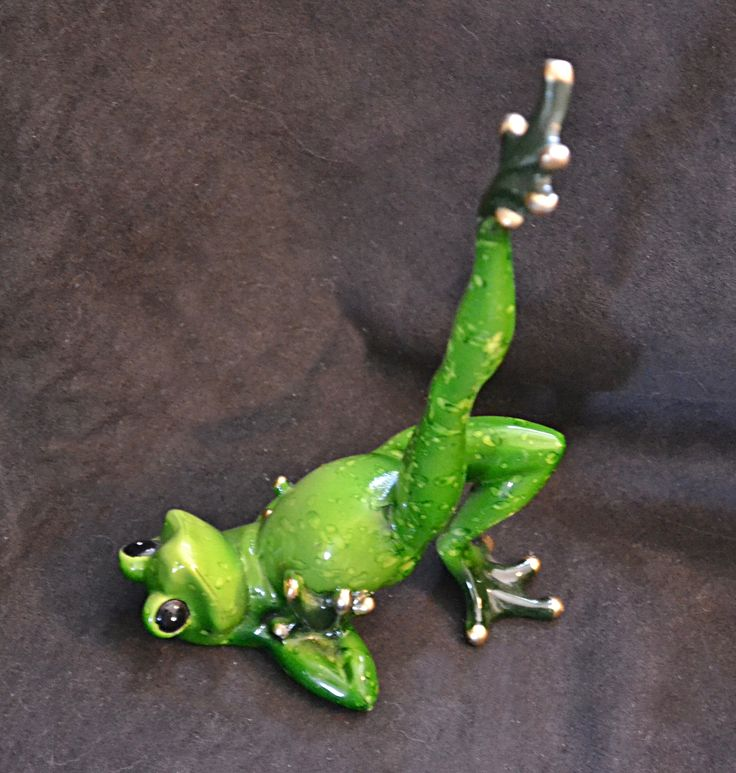 This is an adorable yoga frog.    He measures 20.25 cm (8 inches) tall from tippy to to base and 10cm (4 inches) wide at base. He is brilliant colour, with painted toes of gold. Too cute!    Ships to Canada and U.S.A only. | Shop this product here: spreesy.com/collectitorium/137 | Shop all of our products at http://spreesy.com/collectitorium    | Pinterest selling powered by Spreesy.com