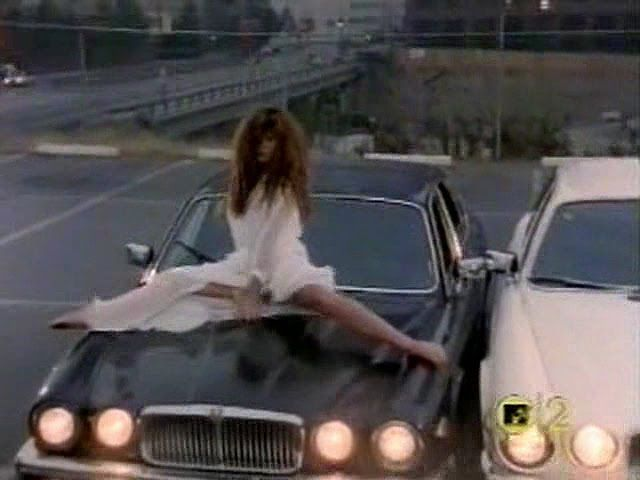 Never cared for Whitesnake, but this music video definitely defines this genre... Tawny Kitaen dancing on the Jaguar.... Nice...