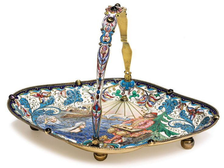 Cake basket marked by Orest Kurliukov (active 1884-1916), Moscow, c.1900. - Silver gilt, full enamel, hardstones semiprecious stones - The decoration depicts the mythical bard Sadko playing his gusli to the sea king's daughter (from Nikolai Rimsky-Korsakov's 1894 opera Sadko). An inscription indicates that the piece was presented to the conductor Arthur Nikisch (1855-1922) in 1904 - L:1.5 in.