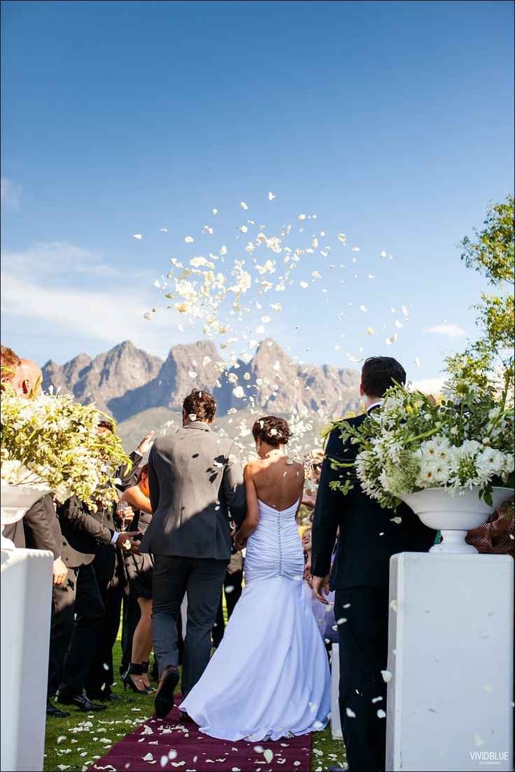 Beautiful shot with confetti and large ceremony flowers