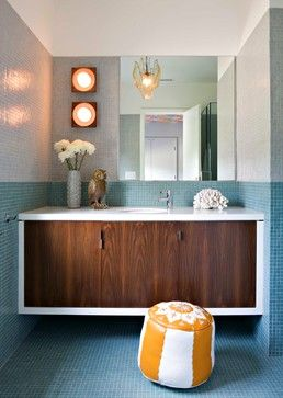 Creative Ideas For A Bathroom Makeover: Mid-mod accessories. A floating white and wood vanity and color-block tile wall set a modern tone in this Los Angeles residence — but it's the midcentury-style ceramic vase and wooden owl that steal the show.  And while the Moroccan-style leather pouf looks amazing in this photo, you'd probably be better off going with an outdoor version if you want to keep it near the shower's splash zone.