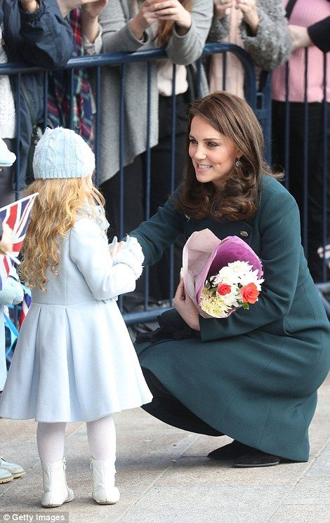 Despite her growing bump, Kate could be seen kneeling down in order to greet the little gi...
