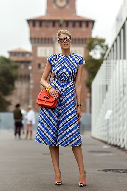 6 Different Ways A Throw-On-And-Go Dress Can Go #refinery29  http://www.refinery29.com/spring-dresses-street-style#slide-4  When you're roughing up a chic tea dress, choose it in a sort of masculine pattern (like a graphic tartan on a slant). It can work as easily with heels as it does with flats.