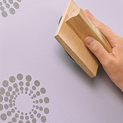 Stamp on a custom wall pattern with a ready-made stamp and metallic paint to give walls a unique finish. We show you how easy it is! | Photo: Graeme Ainscough/IPC Images | thisoldhouse.com
