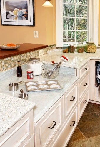 Baking center with marble counter and partial marble backsplash