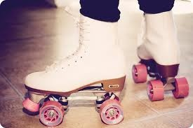 Good old roller skates with pink wheels.  All they need is pom-poms