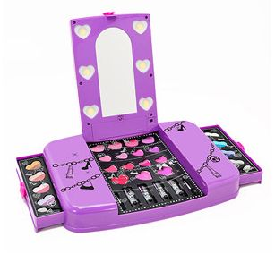 Barbie Light-Up Makeup Vanity (purple) - A gorgeous keepsake vanity stocked with beauty essentials! My daughter would love that!