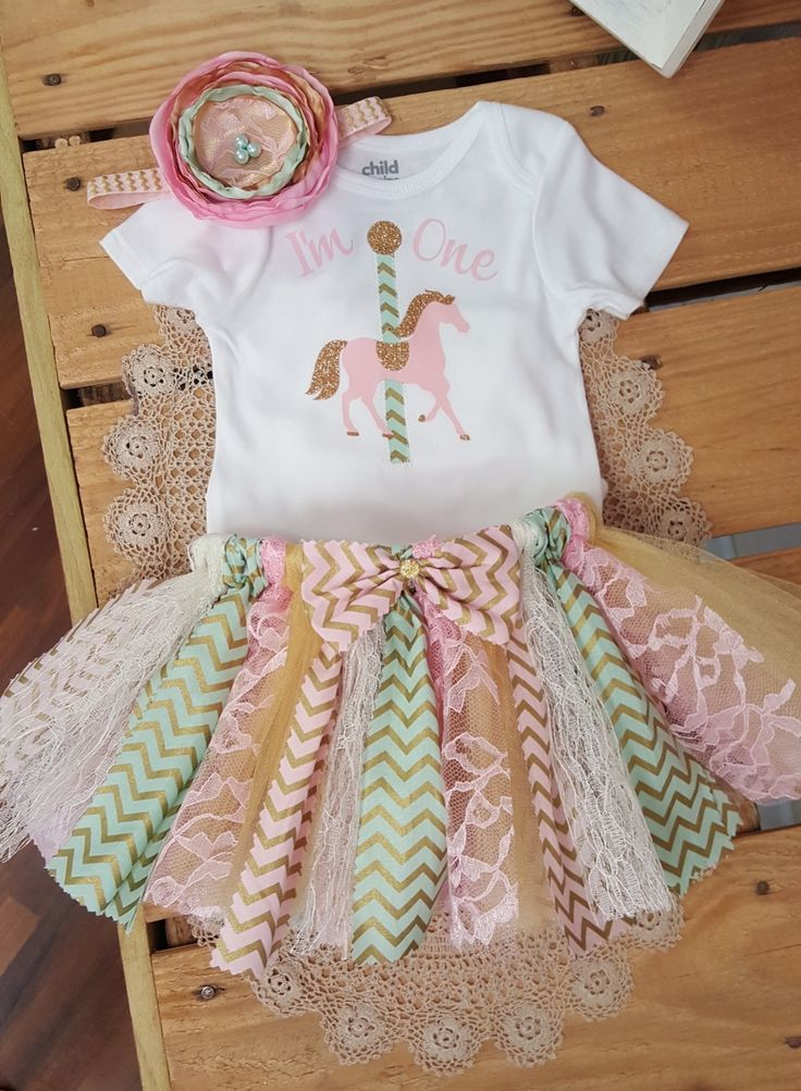 Pink, Mint and Gold Carousel First Birthday Fabric Tutu, 1st Birthday Outfit, First Birthday Girl $40.00 https://squareup.com/store/southernglam/item/pink-mint-and-gold-carousel-first-birthday-fabric-tutu-set?t=modal-pt