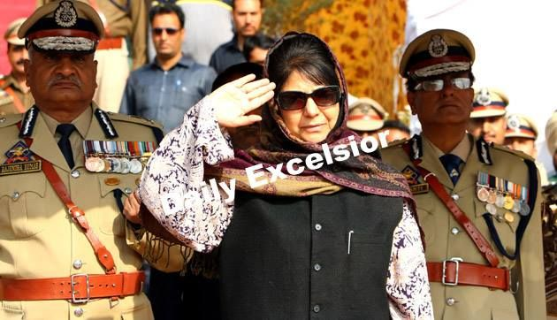 Chief Minister Mehbooba Mufi taking salute during Police Commemoration Day on Friday in Srinagar.Excelsior\Shak- ul - Rehman