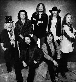 Lynyrd Skynyrd, 1997, promo photo for the new Skynyrd with Johnny Van Zant singing lead (keeping his brother's legacy alive)  Band members from L-R, (standing) Leon Wilkeson, Billy Powell, Johnny Van Zant, Hughie Thomasson, Rickey Medlocke, (sitting) Gary Rossington and Owen Hale... Keep it rockin' guys!