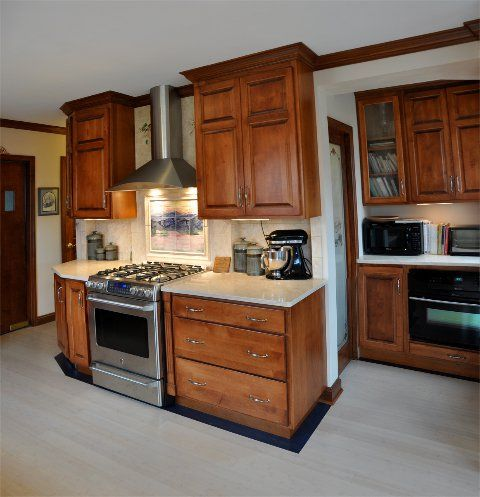 Custom maple cabinetry with customer installed floor and border.