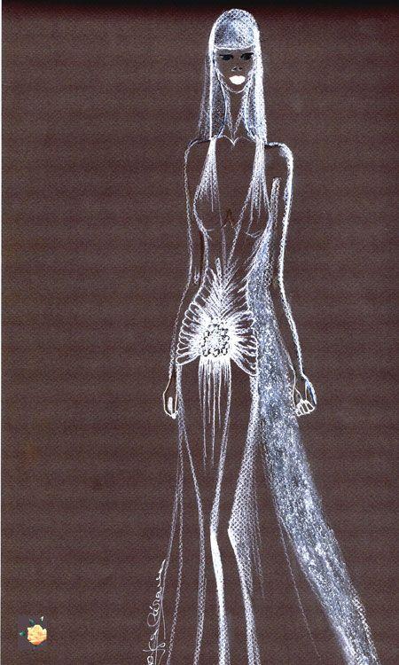 Vestido de novia en chiffón con broche de plata vieja