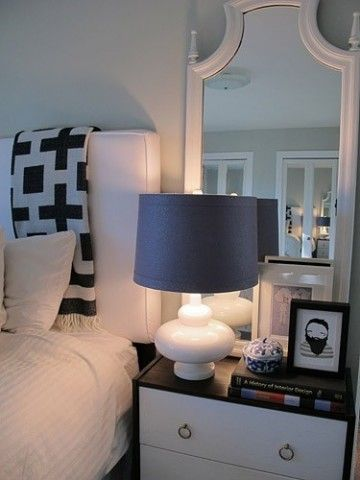 Two great things on this nightstand vignette: 1) Dark lampshade to soften the light 2) Mirror behind lamp to reflect soft, warm light
