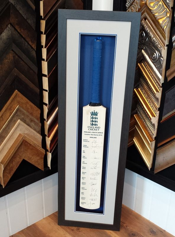 We recently framed a cricket bat, signed by the 2012 England Cricket team.