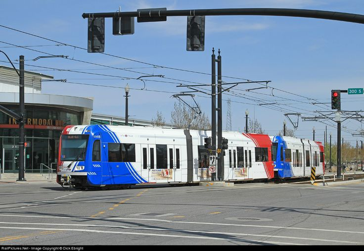 A Utah Transit Authority Blue Line TRAX train arrives at the Salt Lake Central Intermodal Hub. It's passengers can transfer here to UTA buses, FrontRunner commuter rail to Ogden or Provo, Amtrak or Greyhound buses.