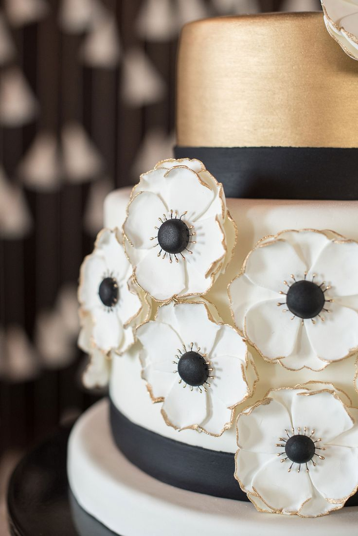 Mikkel Paige Photography pictures of a Raleigh, NC wedding at All Saints Chapel. White, gold and black small wedding cake inspiration with anemone sugar flowers by Edible Art.