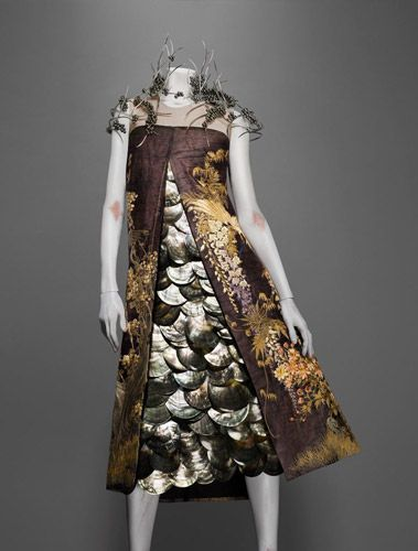 Alexander McQueen (British, 1969–2010)  Ensemble  VOSS, spring/summer 2001  Overdress of panels from a nineteenth-century Japanese silk screen; underdress of oyster shells; neckpiece of silver and Tahiti pearls  Neckpiece by Shaun Leane for Alexander McQueen courtesy of Perles de Tahiti  Dress courtesy of Alexander McQueen