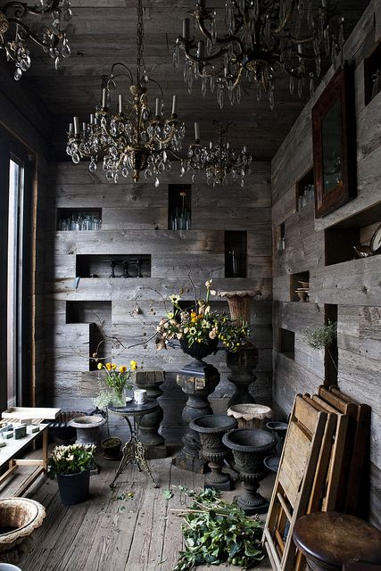wood walls + chandeliers