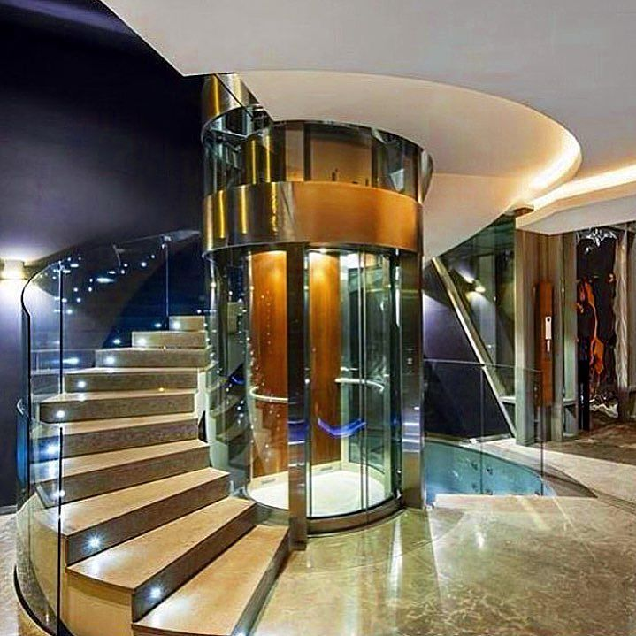 Spiral Staircase With A Glass Elevator In The Middle Of It Modernmansions Dreamhome Mansion Milliona Glass Elevator Luxury House Designs Rich People Houses