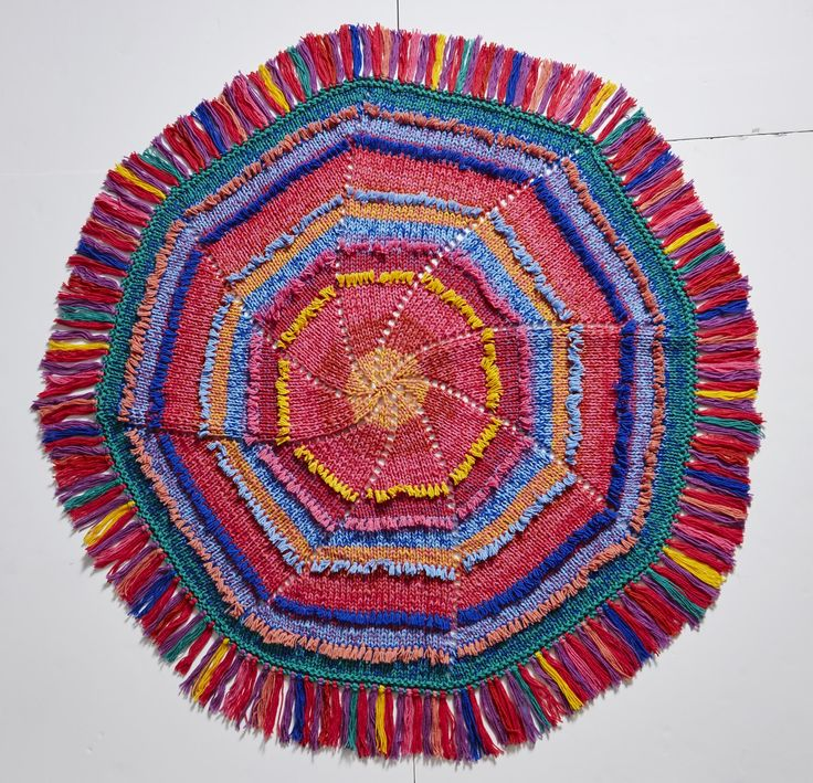 This round, bright 'Boho Chic' style throw is a challenge for a knitting or crocheting extraordinaire. We know you're up to the challenge!  Comes in wool or acrylic.