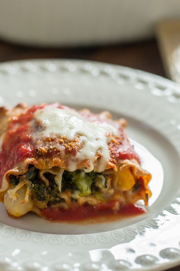 Healthy, hearty vegetable lasagna roll ups with cheese and tomato sauce. Easier than lasagna, but delicious!