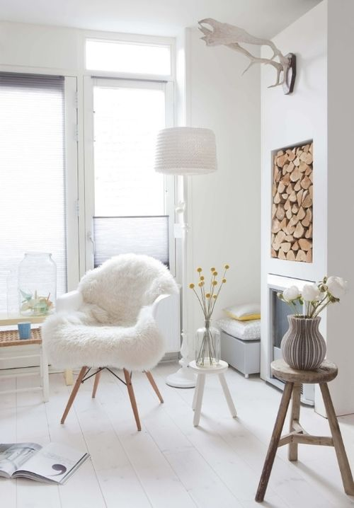 I'm obsessed with the fire wood being stored in the wall, and that chair !: