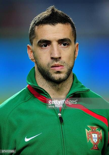 Simao Sabrosa of Portugal lines up during the national anthems prior to the International Friendly match between Portugal and Republic of China at...