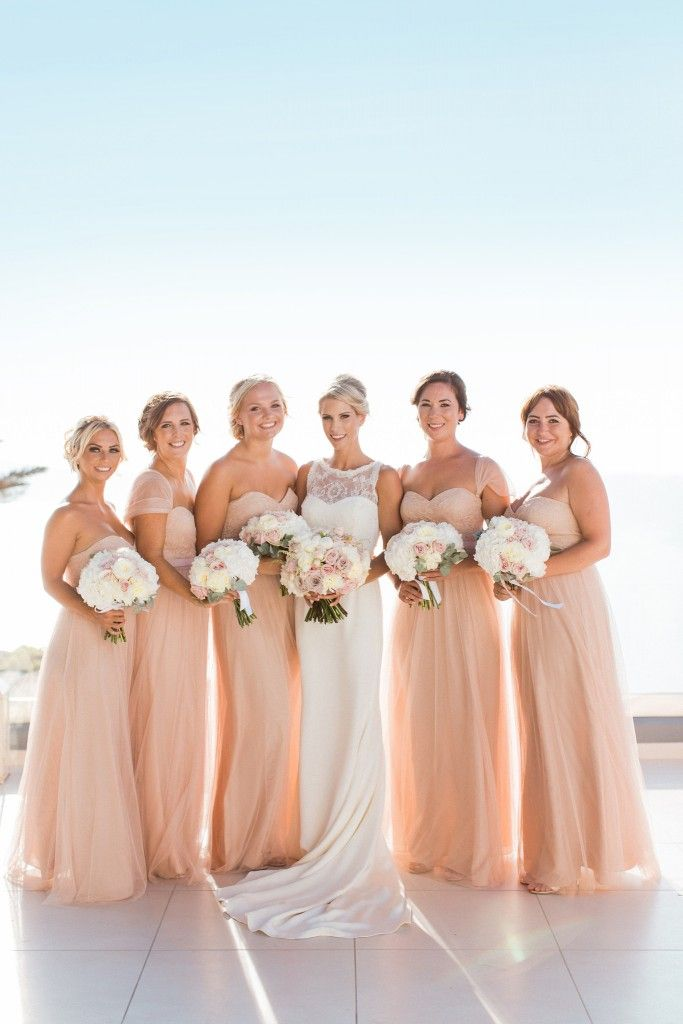 How gorgeous do Alexandra's bridesmaids look in their Jenny Yoo dresses? http://www.styleandthebride.co.uk/an-elegantly-stylish-destination-wedding-in-santorini/
