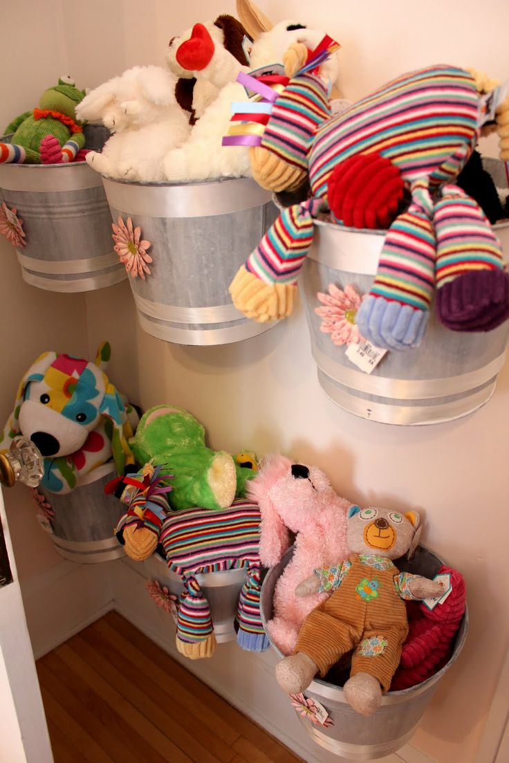 Using Command hooks, you can easily hang buckets on the wall which work well for keeping stuffed animals and other toys off the floor. - 5 Easy Storage and Organization Solutions for Any Kid's Bedroom