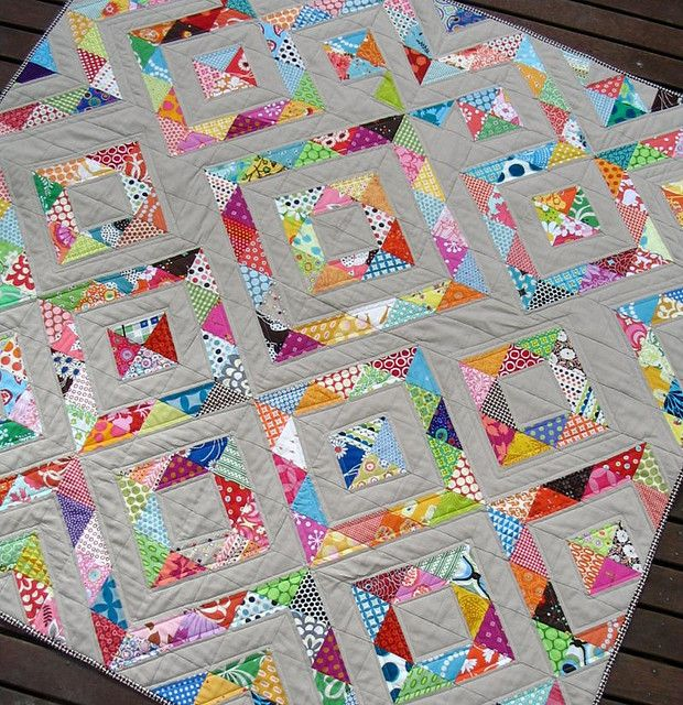 Perfect scrap buster quilt using half square triangles. The solid really makes all of those pretty colors pop.