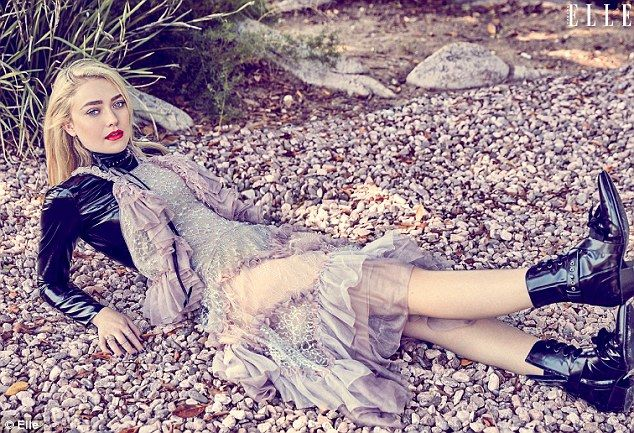 Leggy blonde: The Twilight star flashed her slender pins in a blush and lavender ruffled dress