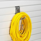 Extension cords stay untangled on a storeWALL Universal hook