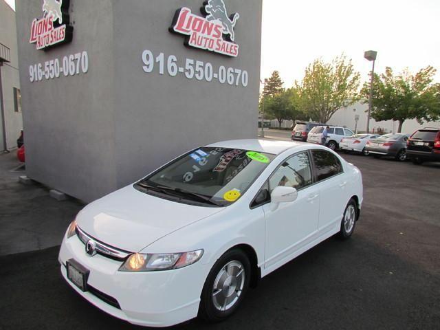 2008 Honda Civic Hybrid, 114,128 miles, $10,950.