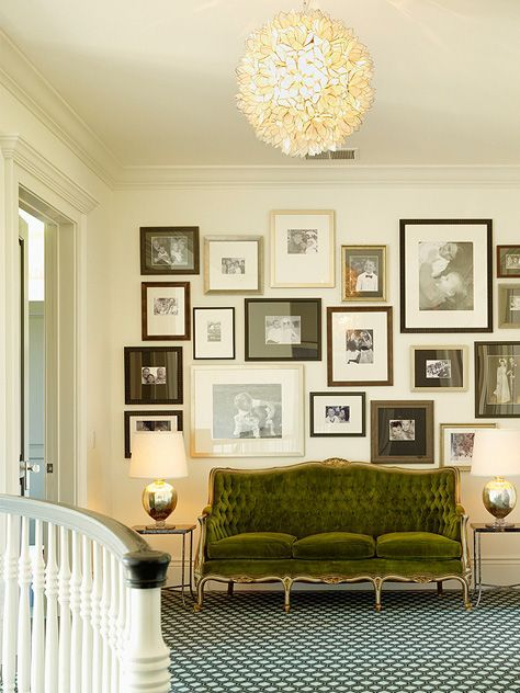 amazing gallery wall and a gorgeous green velvet couch - Love this!
