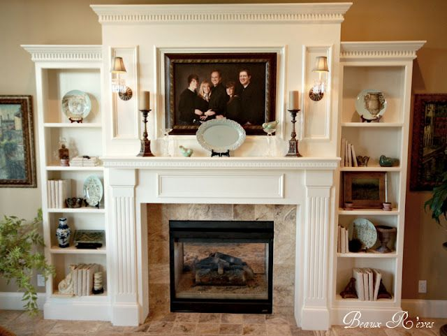 Like the concept of this fireplace surround with built ins. Hate the decorations.