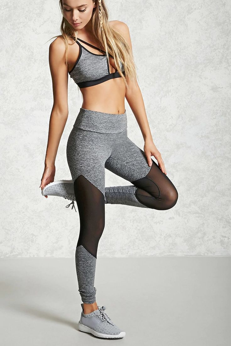 A pair of knit athletic leggings featuring sheer mesh panels, an elasticized waist, and moisture management.