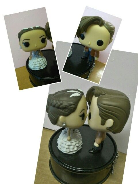 Cake toppers... The girl on fire and the doctor. Living happily ever after