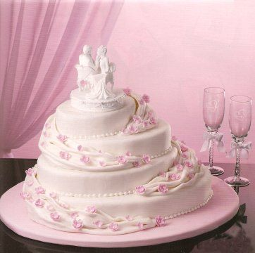Small Pink Flowers Wedding Cake | staggered oval cakes gives this wedding cake an unusual look