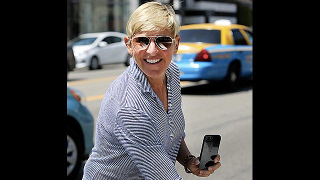 Ellen DeGeneres with her iPhone 5 fitting snugly in her protective CandyShell case