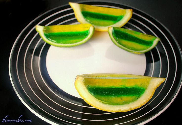 Jello Lime and Lemon wedge shots!                 See how to make them here: http://www.1finecookie.com/2011/06/land-shark-fin-cookies-layered-jello-shot-lemon-lime-wedges-flip-flop-sandwiches/                       #beach #theme #themed #food #recipes #cooking #fun #nom #yum #delicious #4th #july #idependence #day #ideas #sand #cookout #party #summer #liquor #jello #shots #vodka #lemon #lime #drinks