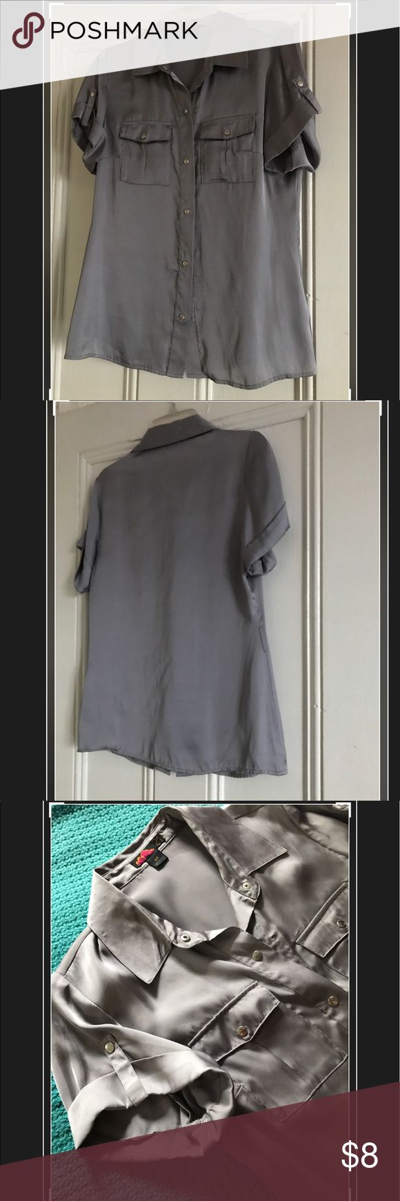 Silver short sleeve blouse Gently worn (maybe twice) silver-grey silky short sleeve blouse. Cute with skinny jeans, leather jacket and heels. Tops Button Down Shirts