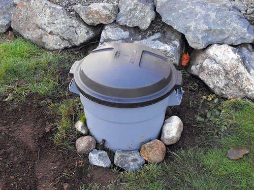 DIY Backyard Organic Waste Digester...Good way to rid the yard of dog waste.