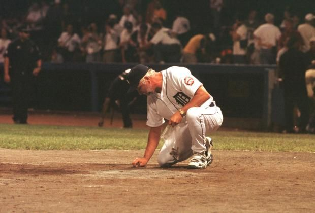 Detroit Tiger, Catcher.... John Wockenfuss  gathers dirt from home plate after the last game ever at Detroit's Tiger Stadium!!! Sept. 27th, 1999  <3