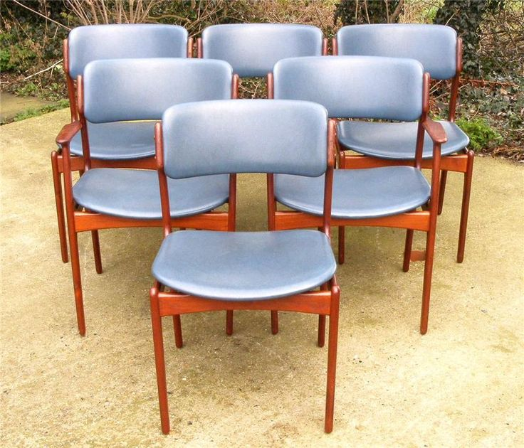 "This is a wonderful set of 6 Danish teak dining chairs by designer Eric Buck dating to 1960's  Set consists of four dining chairs and two carver / arm chairs  These chairs are constructed of high quality teak and are quickly becoming a classic. The chairs have floating seats covered in blue vinyl  Comfort is provided by a deep curve in the backrest.  Label to seats ""Made in Denmark Oddense Maskinsnedkeri A-S""  www.antiques-online.org"