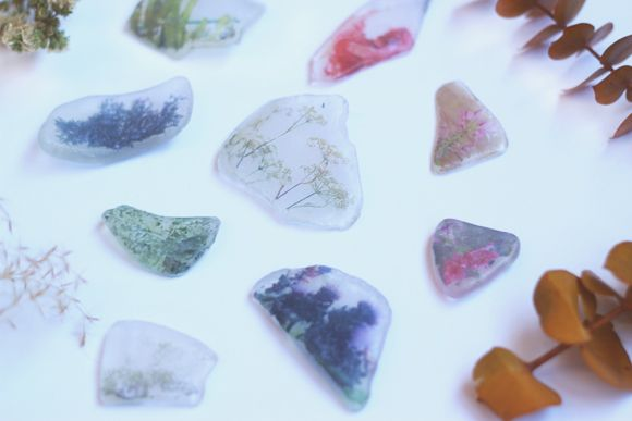 DIY Beach Glass Photo Transfer. These are great to fill up mason jars or to use as decorative paper weights. The best idea is to make necklaces with them. All you need is some cording and a hot glue gun!