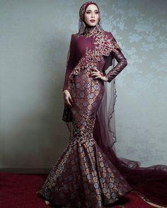 BELLA DALLY wearing a custom marron/rose gold songket dress @bridesbyrizmanruzaini